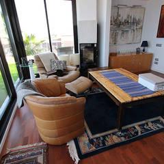 Reforma de vivienda con etiqueta de eficiencia energética A (Gran Alacant, Santa Pola): Salas multimedia de estilo  de Novodeco