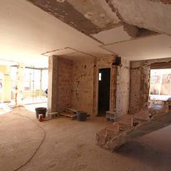 Reforma de vivienda con etiqueta de eficiencia energética A (Gran Alacant, Santa Pola): Paredes de estilo  de Novodeco