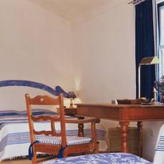 Suite: Quartos  por Stoc Casa Interiores