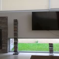 Soleloir: Salas multimedia de estilo  por Arq Andrea Mei   - C O M E I -