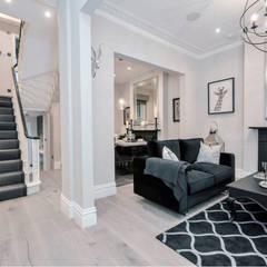 Chelsea townhouse:  Corridor & hallway by adventures in living