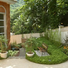Garden by Emmilia Cardoso Designers Associados, Country