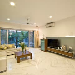 Private Residence at Sopan Baug, Pune:  Living room by Chaney Architects