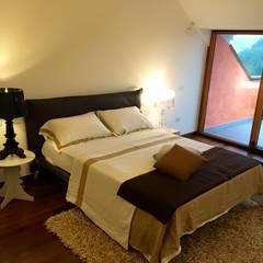 Appartamento a Desenzano del Garda:  Bedroom by Devincenti Multiliving
