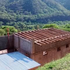 "ARQUITECTURA BIOCLIMATICA ""ECO CIMBRA"" 2: Terrazas de estilo  por FERRER||AGUIRRE ARQUITECTURA+DISEÑO+MUEBLES"