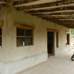 "ARQUITECTURA BIOCLIMATICA ""ECO CIMBRA"" 3: Terrazas de estilo  por FERRER||AGUIRRE ARQUITECTURA+DISEÑO+MUEBLES"