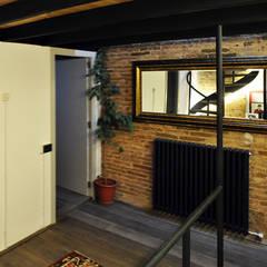 TAQ: Salas multimedia de estilo  de Espais Duals