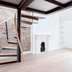 Spiral staircase to the mezzanine:  Corridor & hallway by Railing London Ltd