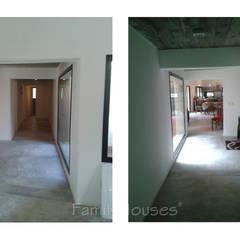 LA CASA DEL BOSQUE: Pasillos y recibidores de estilo  por Family Houses,Clásico