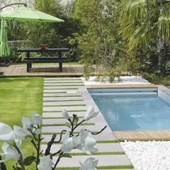 Jardines de estilo moderno de SEVEN GARDEN Moderno