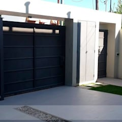 Garage/shed by Arq Olivares