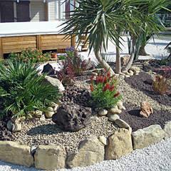 Exemples de réalisations: Jardin de style  par  Les jardins de Laurent