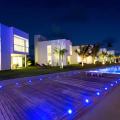 B.Blue Beachouses: Hotéis  por Quattro Arquitetura