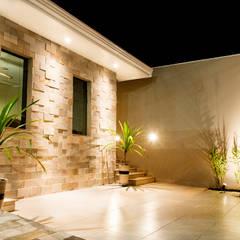 Casa MRT: Casas  por Lozí - Projeto e Obra