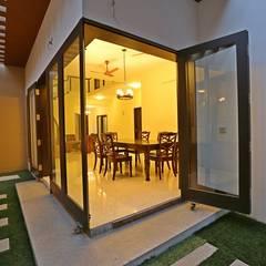 Minimal Melange house:  Garden by Ansari Architects