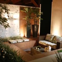 Residência Cruz: Jardins  por Arquitetura Ao Cubo LTDA