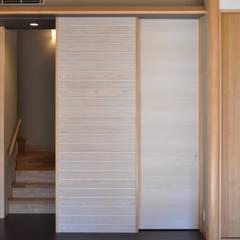 バスケットボールのできる家: (株)独楽蔵 KOMAGURAが手掛けた壁です。,