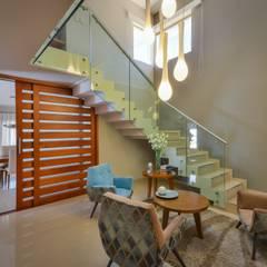 CASA OXIDADA: Livings de estilo moderno por KARLEN + CLEMENTE ARQUITECTOS