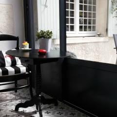 Mini véranda: Terrasse de style  par MJ Intérieurs