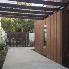vivienda + taller : Terrazas  de estilo  por PARQ Arquitectura