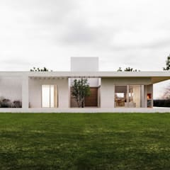 Detached home by 1.61 Arquitectos,