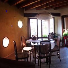 Diseño y Construcción de Casa Caracol en Paine por ALIWEN: Comedores de estilo  por ALIWEN arquitectura & construcción sustentable - Santiago