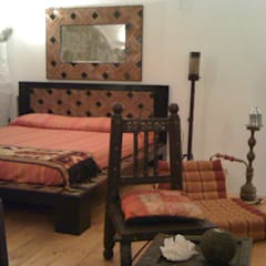 Ambienti etnici: Camera da letto in stile in stile Asiatico di Cesario Art&Design