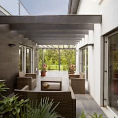 Jardines de invierno de estilo  por Spazio Positivo
