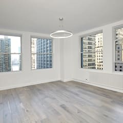Downtown White on White Apartment: minimalistic Living room by Andrew Mikhael Architect