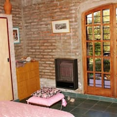 Dormitorio: Dormitorios de estilo rústico por Liliana almada Propiedades