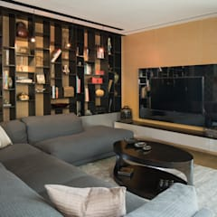 Penthouse Punto Central: Salas multimedia de estilo moderno por Línea Vertical