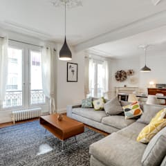Aménagement d'un appartement haussmannien: Salon de style  par Decorexpat