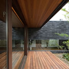 Okayama K.K_House: バウムスタイルアーキテクト一級建築士事務所が手掛けた庭です。