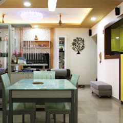 asian Dining room by Ashpra Interiors