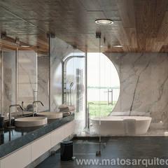 House by River side: Casas de banho  por Matos Architects
