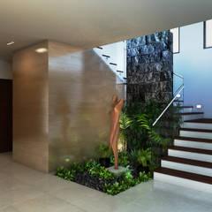 Residencia AC: Pasillos y recibidores de estilo  por Interiorisarte