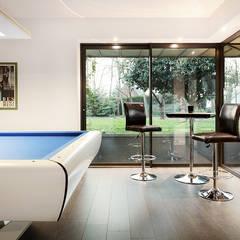 Extension salle de billard: Jardin d'hiver de style  par O2 Concept Architecture