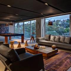 Canelos - RIMA Arquitectura: Salas multimedia de estilo  por RIMA Arquitectura