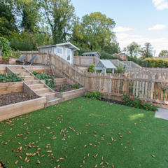 Jardines de estilo  por Hampshire Design Consultancy Ltd.,