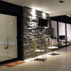 Casa M2 - Estudio Fernandez+Mego: Jardines de invierno de estilo  por Estudio Fernández+Mego