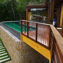Pool by Baixo Impacto Arquitetura Ltda.