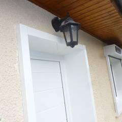 Menuiseries extérieures PVC: Fenêtres de style  par Améko