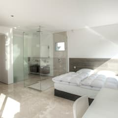 Casa del Agua: Dormitorios de estilo minimalista de MG&AG.ARQUITECTOS