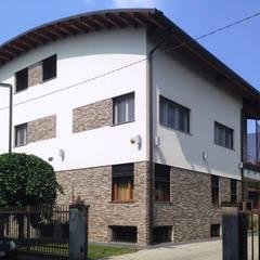Projekty,  Dom z drewna zaprojektowane przez Marlegno