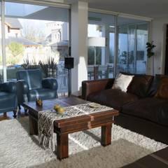 ESTAR Poggi Schmit Arquitectura Livings modernos: Ideas, imágenes y decoración