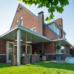Verbouwing woonhuis Nootdorp:  Terras door Architect2GO