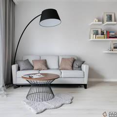Mieszkanie pokazowe: styl , w kategorii Salon zaprojektowany przez Partner Design