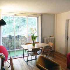 Appartement P: Salle à manger de style de style Minimaliste par Agence 1+1