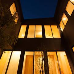 堀端の家: 浅野翼建築設計室が手掛けた庭です。