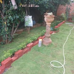 Mrs. Ganga's Private Residence:  Garden by Cherry Garden and Landscapers